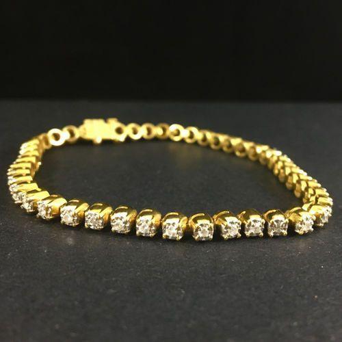 Złota bransoleta z diamentami - B458