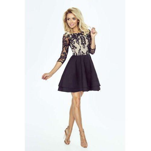 dc5ed778fa Czarna rozkloszowana elegancka sukienka z gipiurą marki Imesia 338