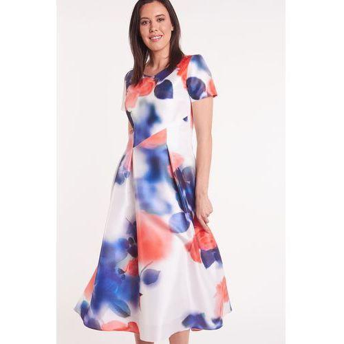 75bb51596 Elegancka sukienka w kwiaty GOLDA 489,00 zł Wizytowa sukienka o długości  midi, za kolano. Jasna w motyw kwiatowy, lekko rozmyty. Piękny dekolt w  serek, ...