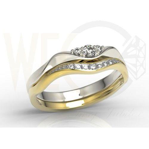 Pierścionek składany z żółtego i białego złota pr. 0,585 z diamentami i elementem rodowanym.