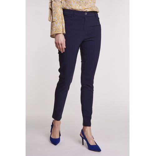 7665c425c2ec46 Granatowe spodnie o dopasowanym kroju - EMOI, 1 rozmiar 199,00 zł Granatowe  spodnie to komponent stroju, który stanie na wysokości zadania w wielu ...