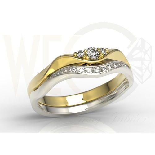 Pierścionek składany z białego i żółtego złota pr. 0,585 z diamentami.
