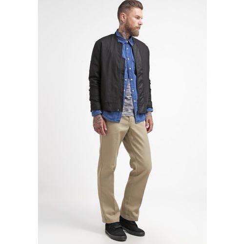 Dickies Spodnie materiałowe khaki - produkt z kategorii- spodnie męskie