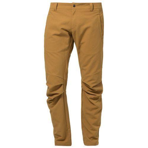Produkt z kategorii- spodnie męskie - ODLO Spodnie materiałowe złoty